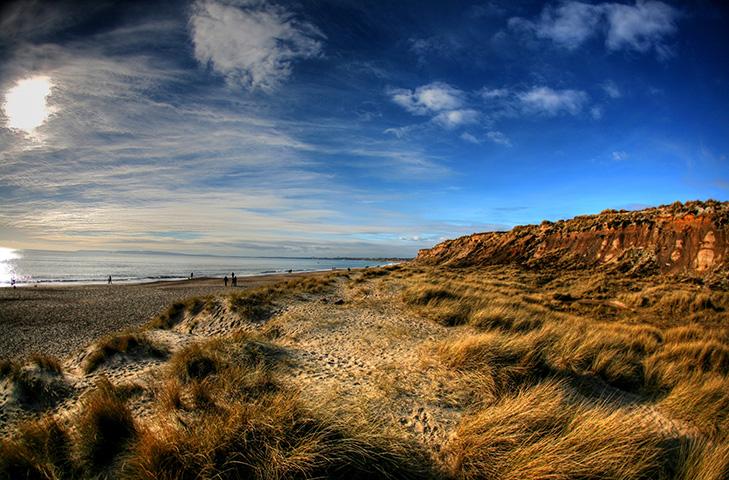 Blue skies over the sandy grasslands at Hengistbury Head