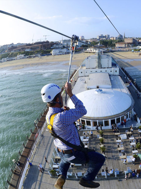 Guest zip lining from Bournemouth pier to the beach