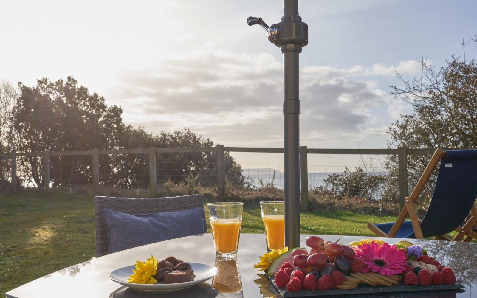 Outdoor table and chairs area with a breakfast spread waiting for guests