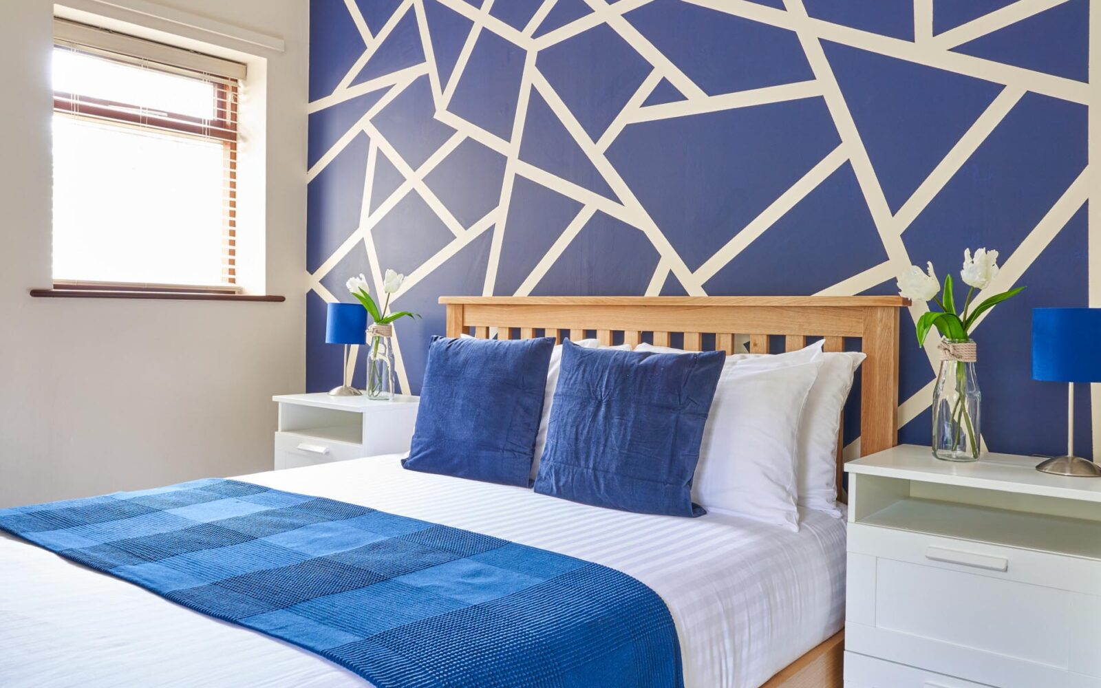 Steamer Points master bedroom featuring blue and white colours throughout