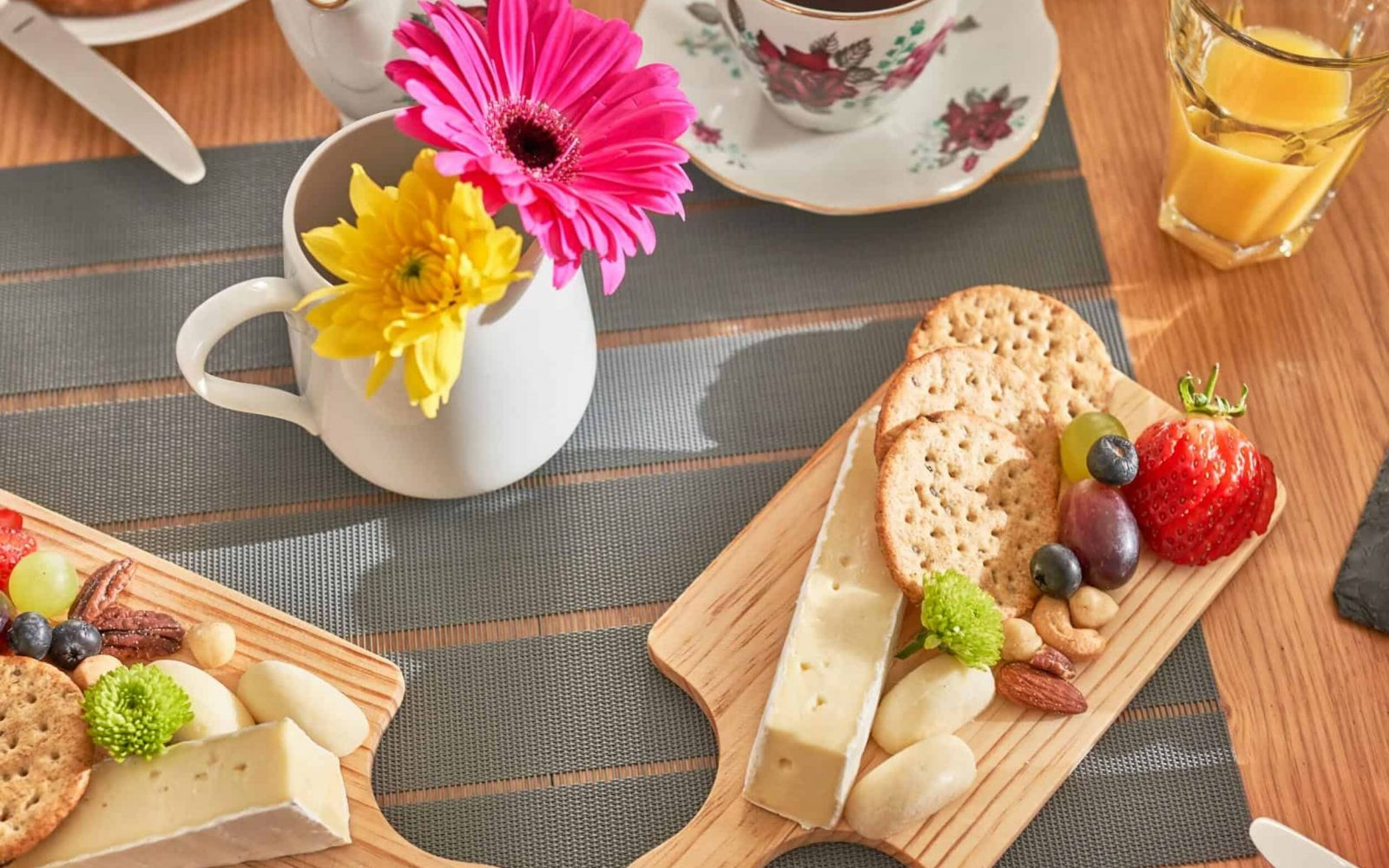 Mouth watering spread of Cheese & crackers presented on wooden boards